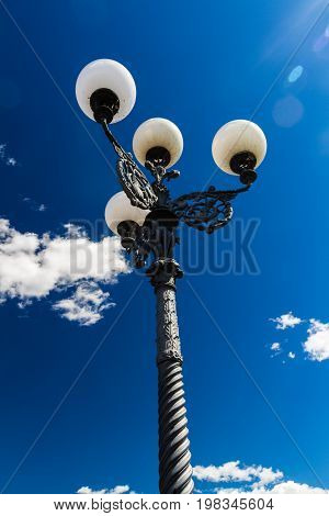 Florentine streetlamp against sky, in Florence italy