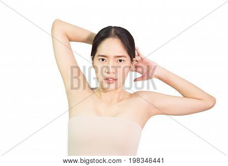 Beautiful young Asian woman show armpit that slick white , skin care and clean skin and spa concept , isolated on white background