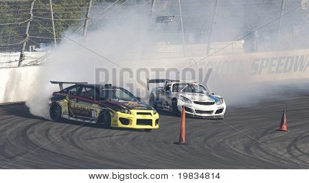 IRWINDALE, CA. - OCTOBER 16: Tanner Foust (L) and Darren McNamara (R) compete at Toyota Speedway during Formula Drift round 7 on October 16th 2009 at the Toyota Speedway in Irwindale.