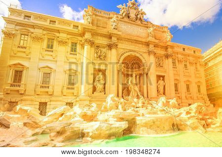 Spectacular Trevi Fountain at sunset, designed by Nicola Salvi Baroque era, in a sunny day, one of the most famous fountains in the world, capital of Rome, Lazio, Italy.