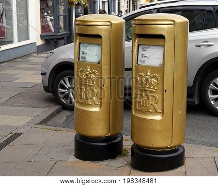 Bridge Street, Stratford-upon-avon, Uk - July 21 2017: Two Gold British Pillar Boxes Or Post Boxes,