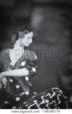 Standard mannequin of woman dancing sevillanas in black and white