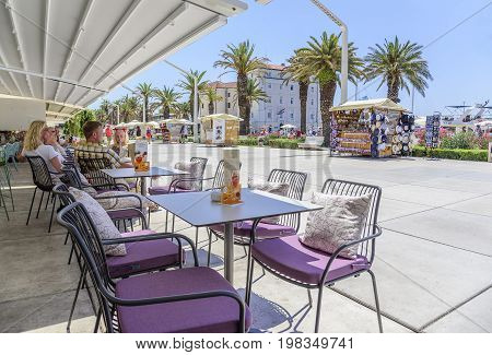 SPLIT, CROATIA - JULY 12, 2017: The view from the cafe on the promenade in the resort town of Split in Croatia.