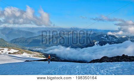 Man walking in mountains. Easton Glacier. Railroad Grade Trail. Mount Baker. North Cascades National Park. Seattle. Washington. United States.