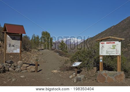 Yerba Loca, Santiago, Chile - July 26, 2017: Start of the Condor Trail in the mountainous landscape of Parque Yerba Loca set in a glacial valley close to Santiago, capital of Chile.