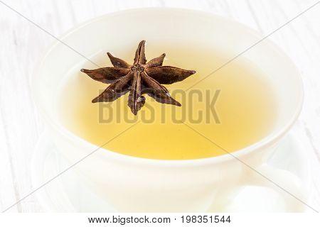 Chamomile (Matricaria chamomilla) and star anise (Illicium verum) infusion