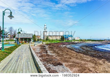 Sainte-Luce Canada - June 5 2017: Coast of village in Gaspesie region of Quebec during day with boardwalk and Saint Lawrence river