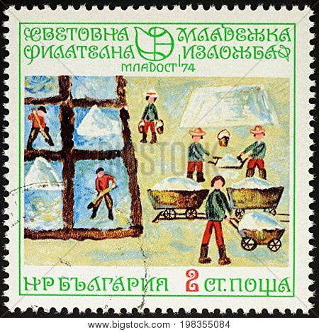 Moscow Russia - August 04 2017: A stamp printed in Bulgaria shows children's drawing of Salt huts working people series