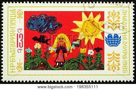 Moscow Russia - August 03 2017: A stamp printed in Bulgaria shows children's drawing of girl in the countryside series