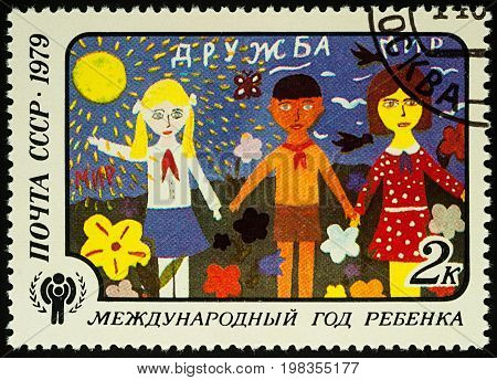 Moscow Russia - August 04 2017: A stamp printed in USSR (Russia) shows children's drawing of Friendship series