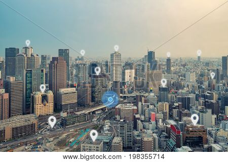 Searching location on map and pin above Osaka city and network connection internet of things satellite navigation system concept