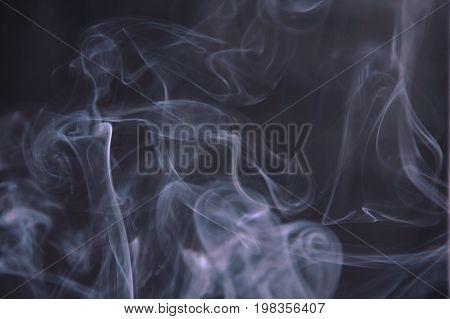 smoke floating without direction on black background