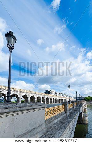 Bercy bridge against blue sky in Paris, France