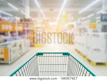 Supermarket store abstract blur background with shopping cart Supermarket aisle with empty shopping cart