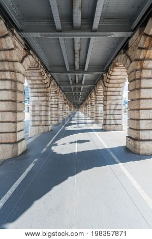 vanishing point view from under Bercy  bridge in Paris, France