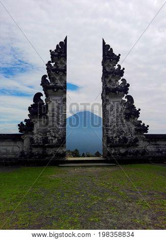 Pura Lempuyang, Bali, Indonesia - July 2017: The landscape to Agung volcano
