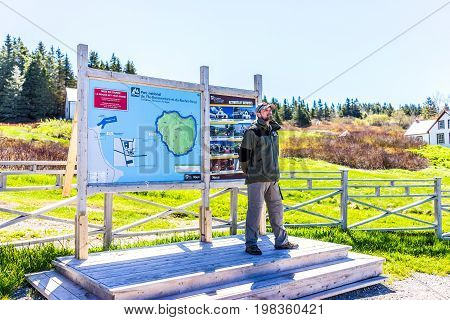 Perce Canada - June 6 2017: Bonaventure Island Park entrance in Gaspe Peninsula Quebec Gaspesie region with ranger standing by map and signs