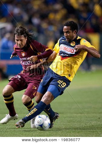 CARSON, CA. - JANUARY 9: Daniel Alcantar (L) & Jean Beausejour (R) in action during the InterLiga 2010 match of Club America & Estudiantes Tecos at the Home Depot Center January 9, 2010 in Carson, CA.