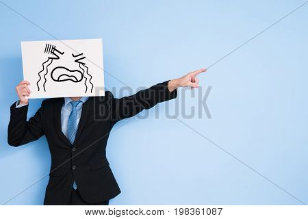 businessman take cry billboard and show something on blue background