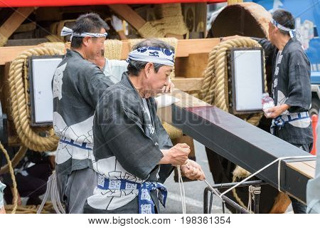 Kyoto, Japan - July 17, 2016: Japanese Men In Traditional Clothing Preparing Yamaboko Float In Gion