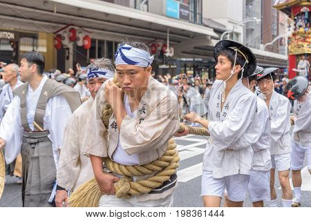Kyoto, Japan – July 17, 2016: Japanese Men In Traditional Clothi
