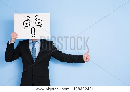 businessman take surprise billboard and thumb up on blue background