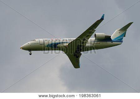 SAINT PETERSBURG, RUSSIA - JULY 03, 2016: Passenger plane Bombardier CRJ-200ER (VQ-BSB) Yamal Airlines in a cloudy sky closeup