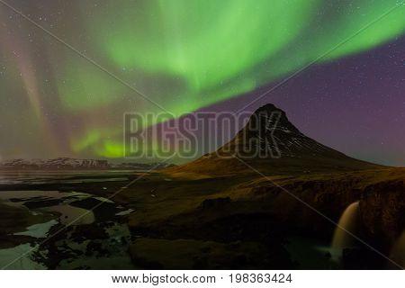 Iceland volcano with northern light natural landscape background
