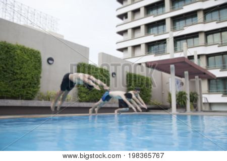 Young Man Wearing Swimming Costume Jump in Swimming pool
