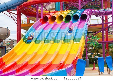 Phuket Thailand - 8 July 2017 - Happy vacationers slide down giant sliders at Splash Jungle Water Theme park in Phuket Thailand on July 8 2017