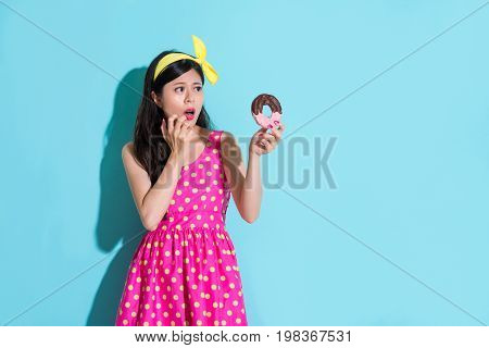 Young Beauty Girl Looking At Sweet Tasty Doughnut