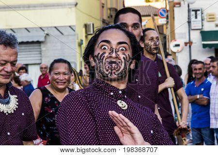 QUARTU S.E. ITALY - JULY 18 2015: 29 Sciampitta - International Folklore Festival - New Zealand folk group parade - Sardinia