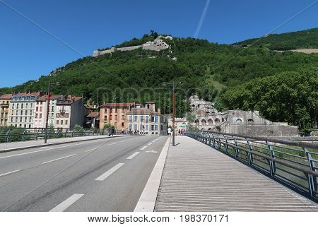 Street of Grenoble with view on the Bastille