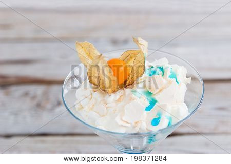 Eton mess meringue blue curacao and physalis.