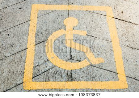 Handicap disabled sign for parking, Road in Thailand.