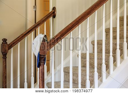 Hat on Banister by Stairs in New Home