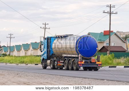 Lorry With Chrome Tanker On A Large Paved Road