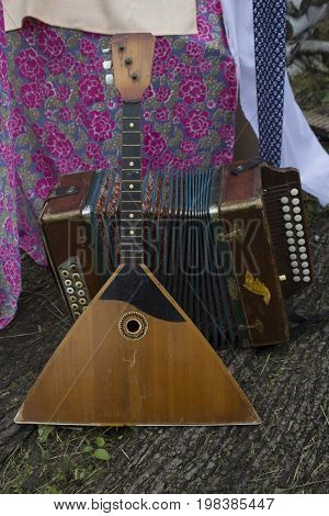 From Russia with love. Russian folk instruments. Welcome to Russia. A summer festival. Play the harmonica. Play balalaika