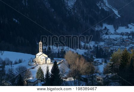 Prato Leventina Switzerland - 29 December 2010: Winter landscape with the church of Prato Leventina on the Swiss alps