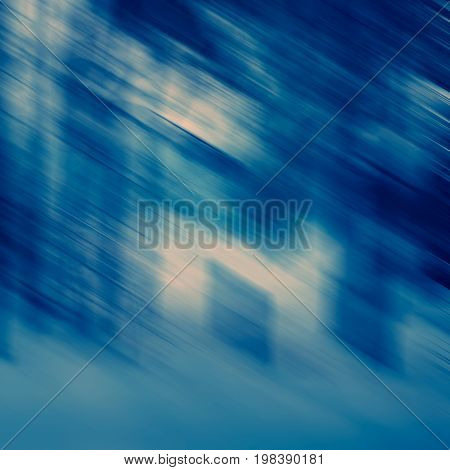 Abstract diagonal spots and lines in blue tonality blurred background