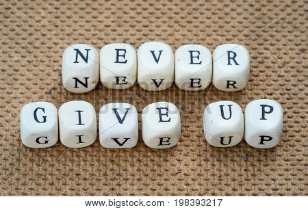 never give up words made from toy cubes with letters