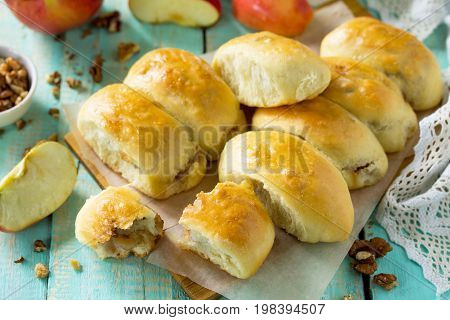Homemade Apple Pies With Fresh Apples And Walnuts From Yeast Dough On A Kitchen Wooden Table. Apple