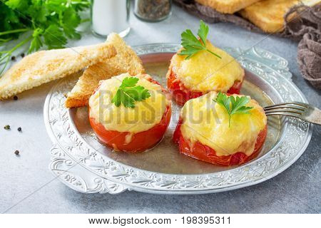 Stuffed Tomatoes. Tomatoes Baked With Cheese And Chicken, Served With Croutons Of White Bread.
