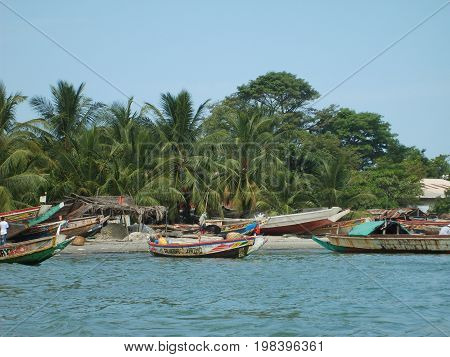 Gambia coast with colorful painted fishing boats