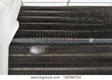 closeup of broken aluminium condenser in air conditioner