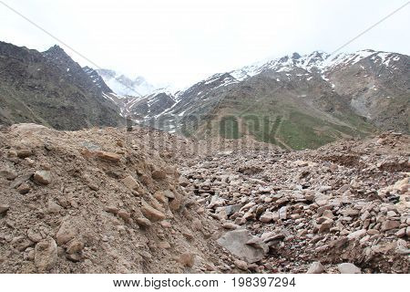 The mountain road destroyed after melting snow