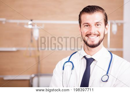 Male Doctor with stethoscope arround his neck in hospital recovery room. Medicine and healthcare