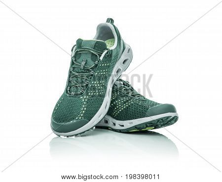 Unbranded modern sneakers isolated on a white background. Green sneakers.