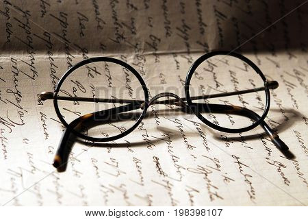 Old,vintage glasses on a hand writted letter