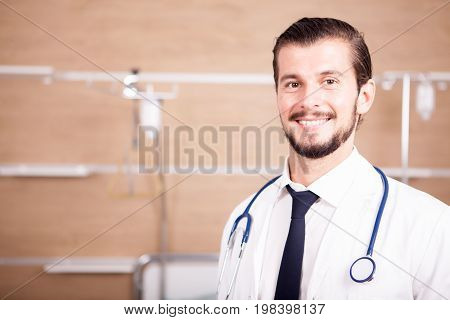 Doctor with stethoscope arround his neck in hospital recovery room. Medicine and healthcare